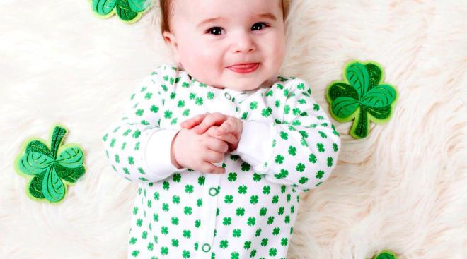 happy baby wearing st patrick's clover onesie