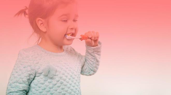 toddler brushing her teeth
