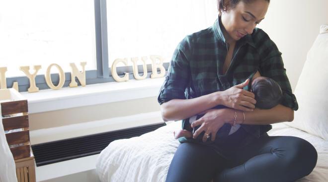 mom breastfeeding her new born baby