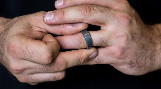 man cleans his wedding ring everyday as a symbol of a happy marriage
