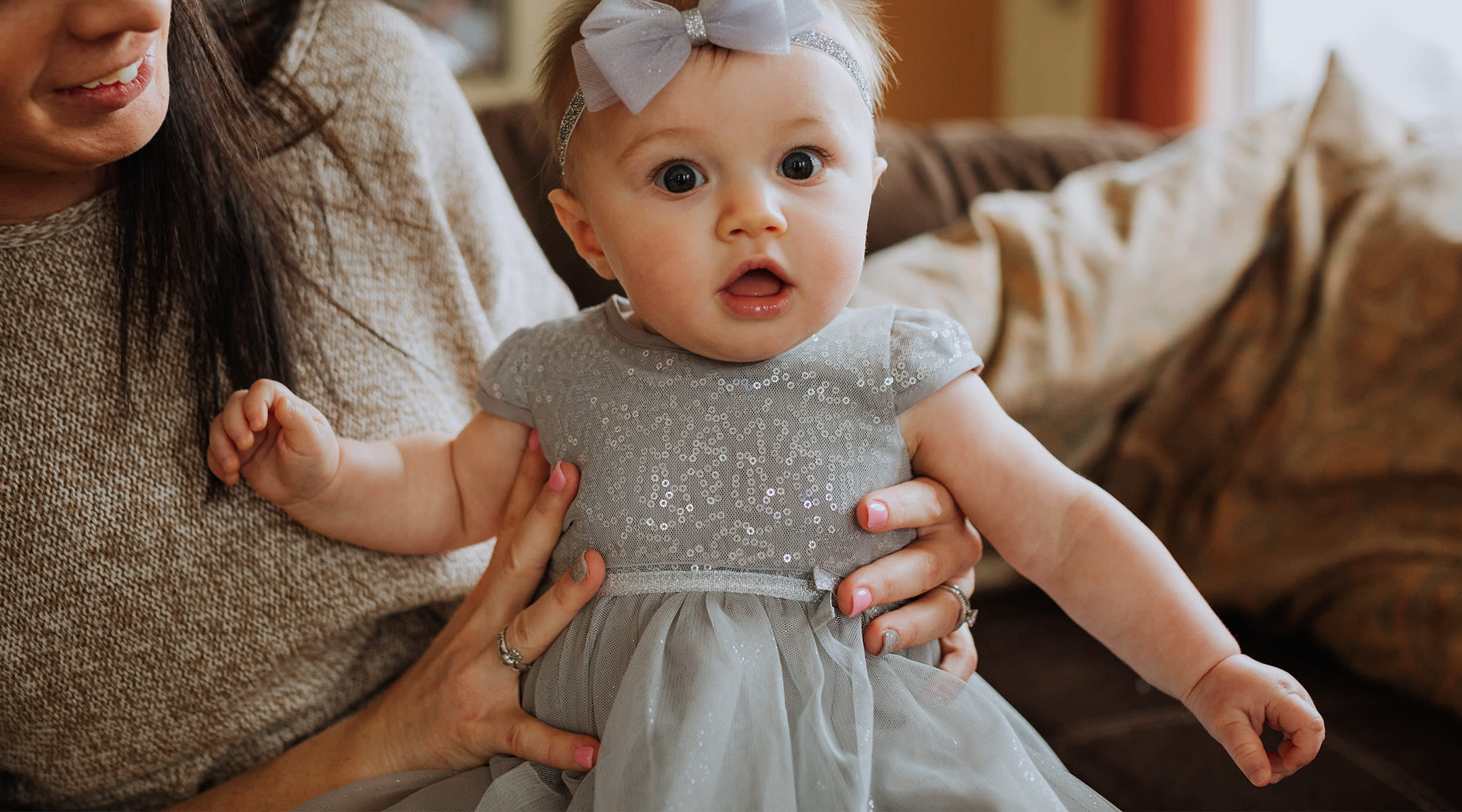 baby girl in formal dress for a wedding