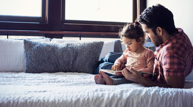dad and daughter reading children's book