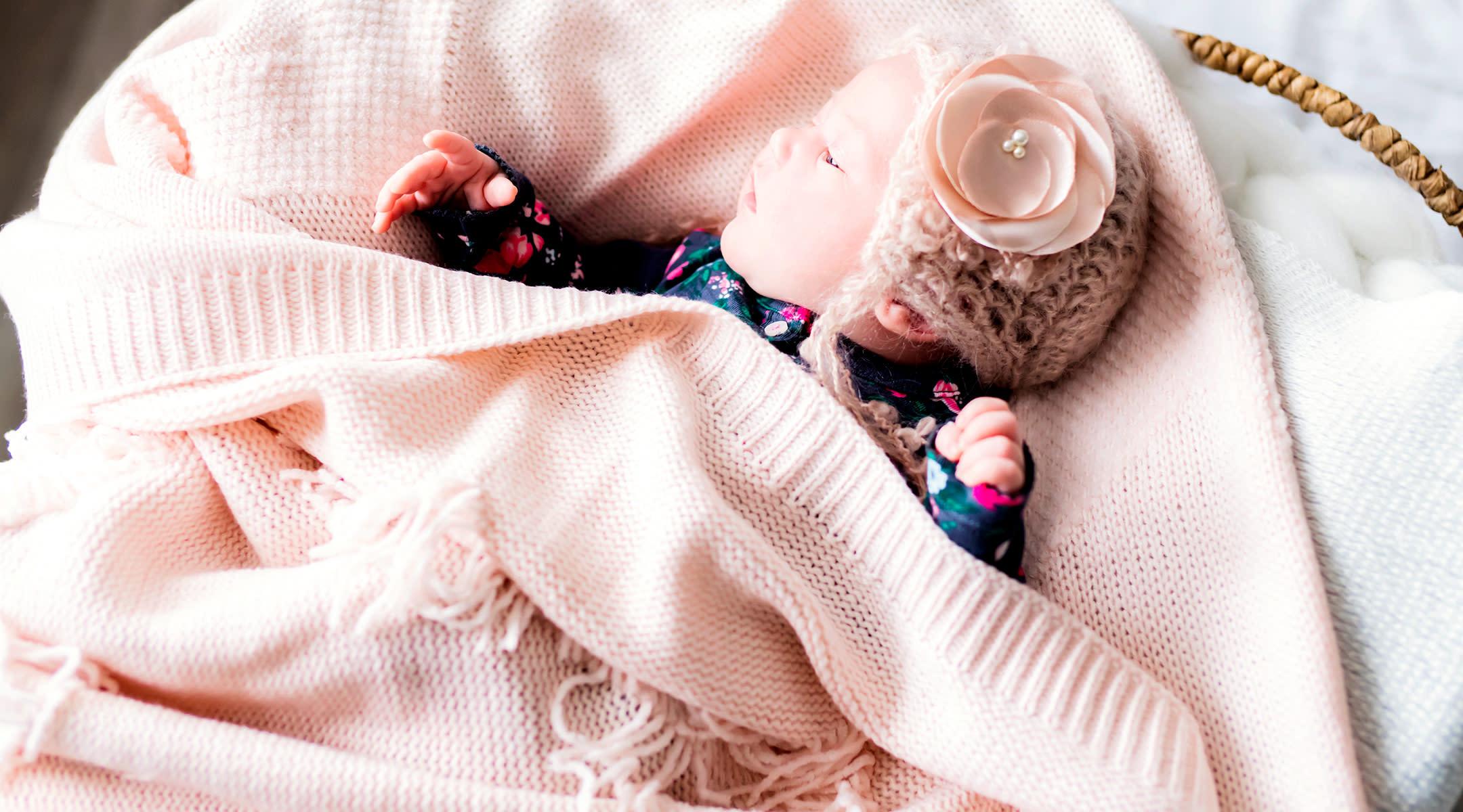 newborn baby wearing a pink knit hat