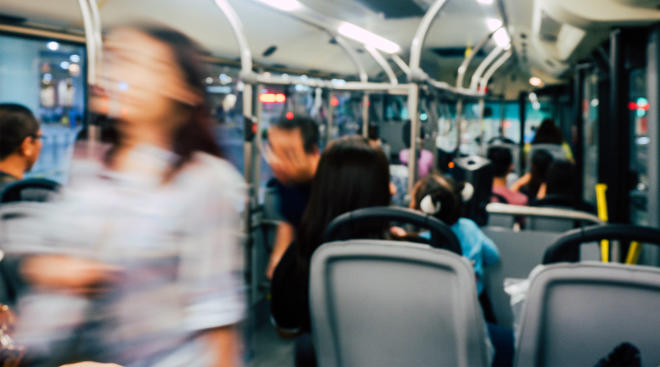 interior of bus with blurry people
