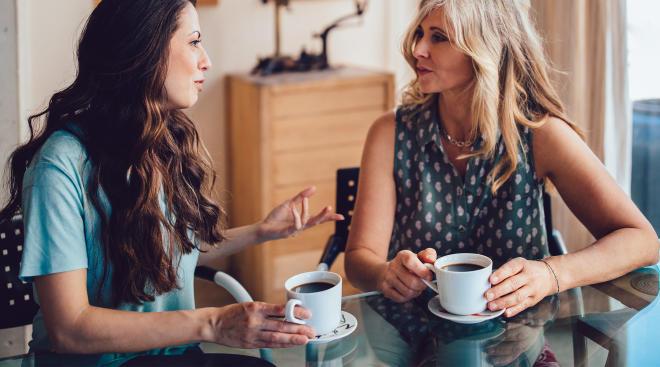 two women having serious conversation