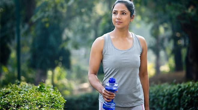 woman enjoying an exercise walk outdoors