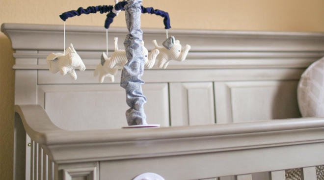 elephant baby mobile hanging on crib
