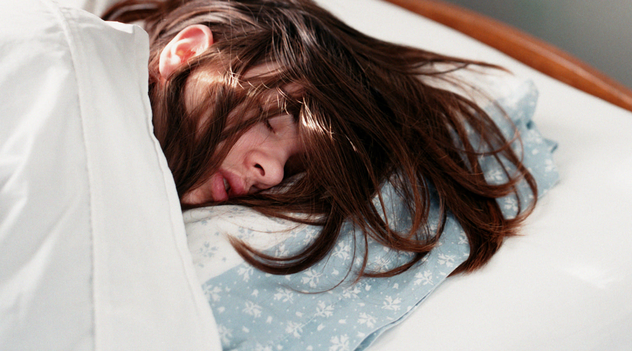 woman asleep on side in bed