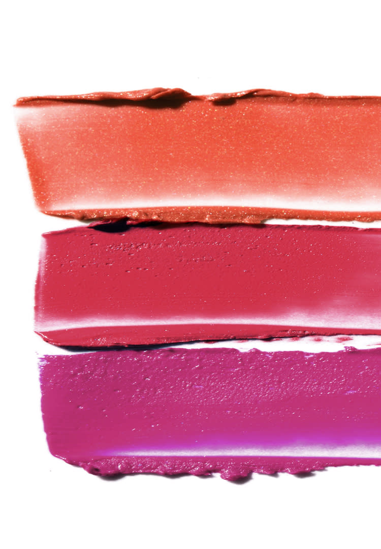 Three colorful lipstick smears.