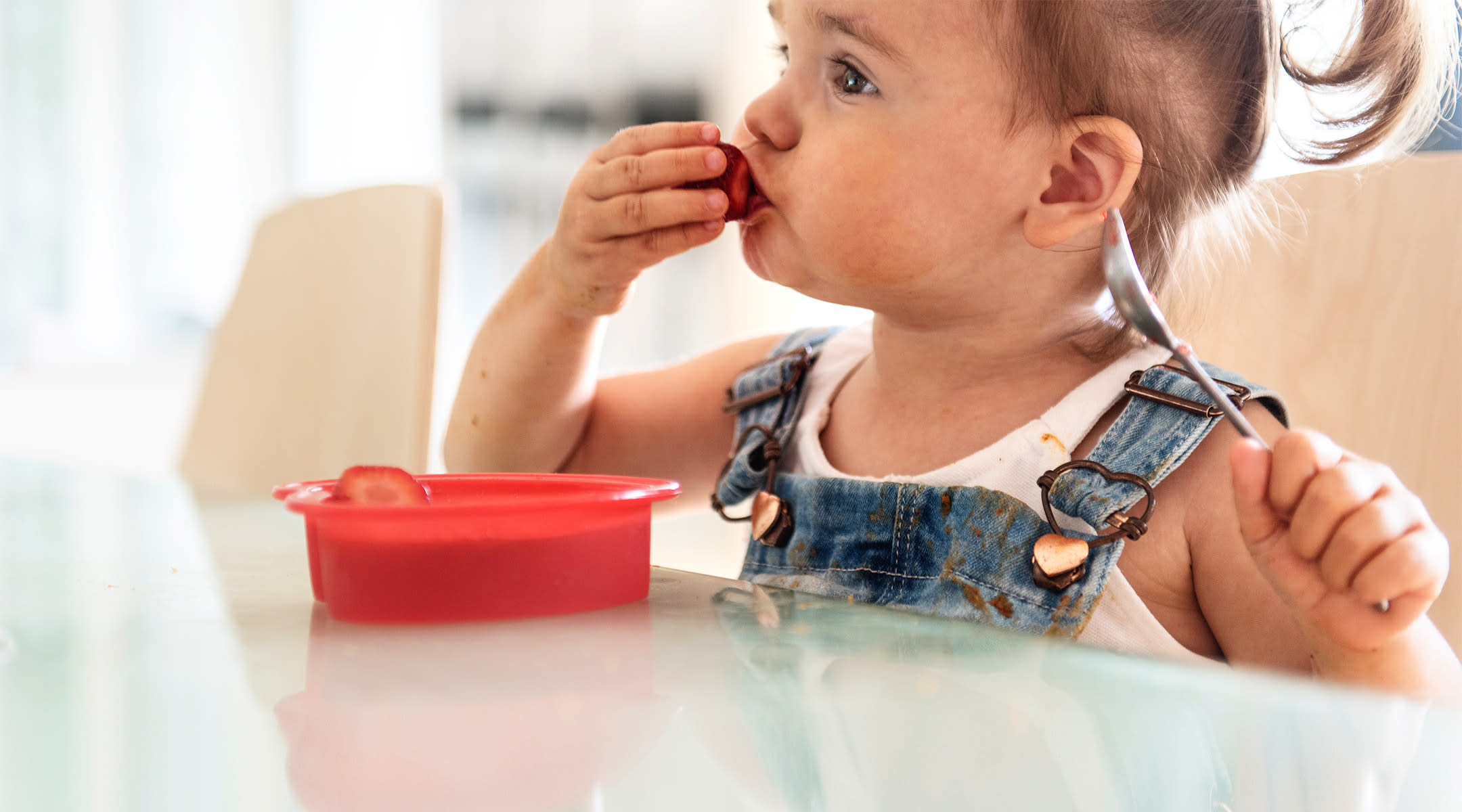 Toddler eating snack on the go