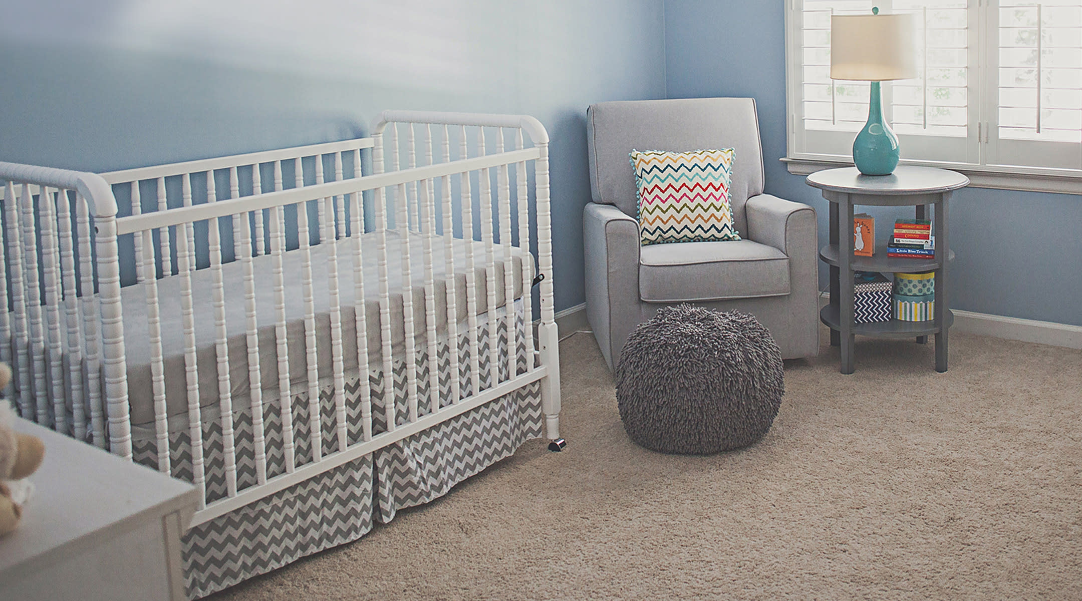 Baby nursery with blue walls.