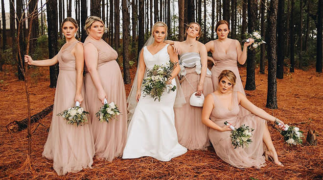 bridesmaid pumping during wedding photos