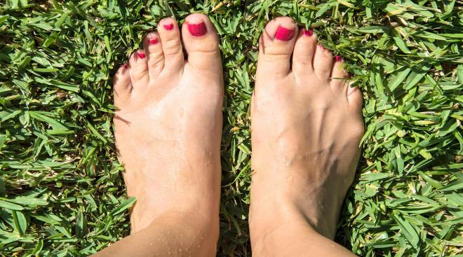 swollen feet standing on grass