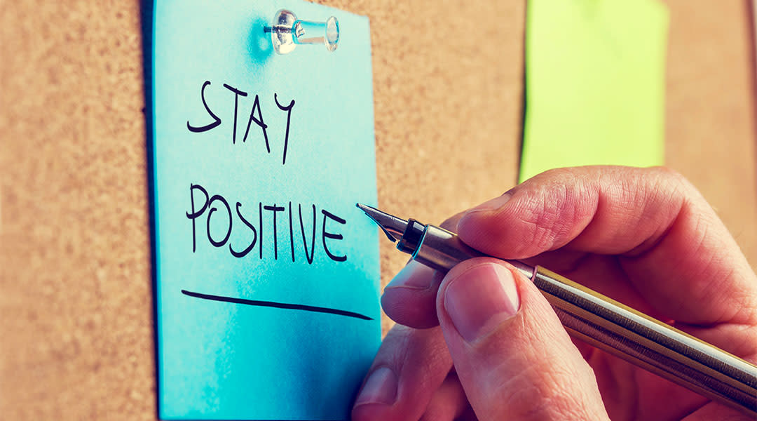 hand writing on sticky note, stay positive