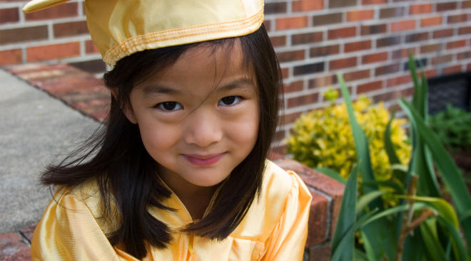 pre-school age girl on pre school graduation day