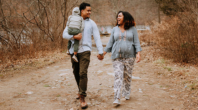 couple walking, expectant mom and partner with toddler