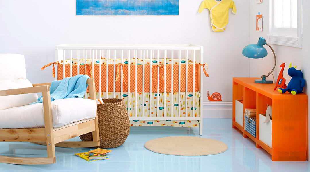 baby nursery with crib that has bumpers