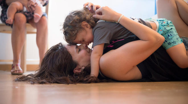 emotional mom and toddler son hug