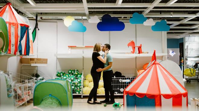 couple does their maternity shoot in ikea