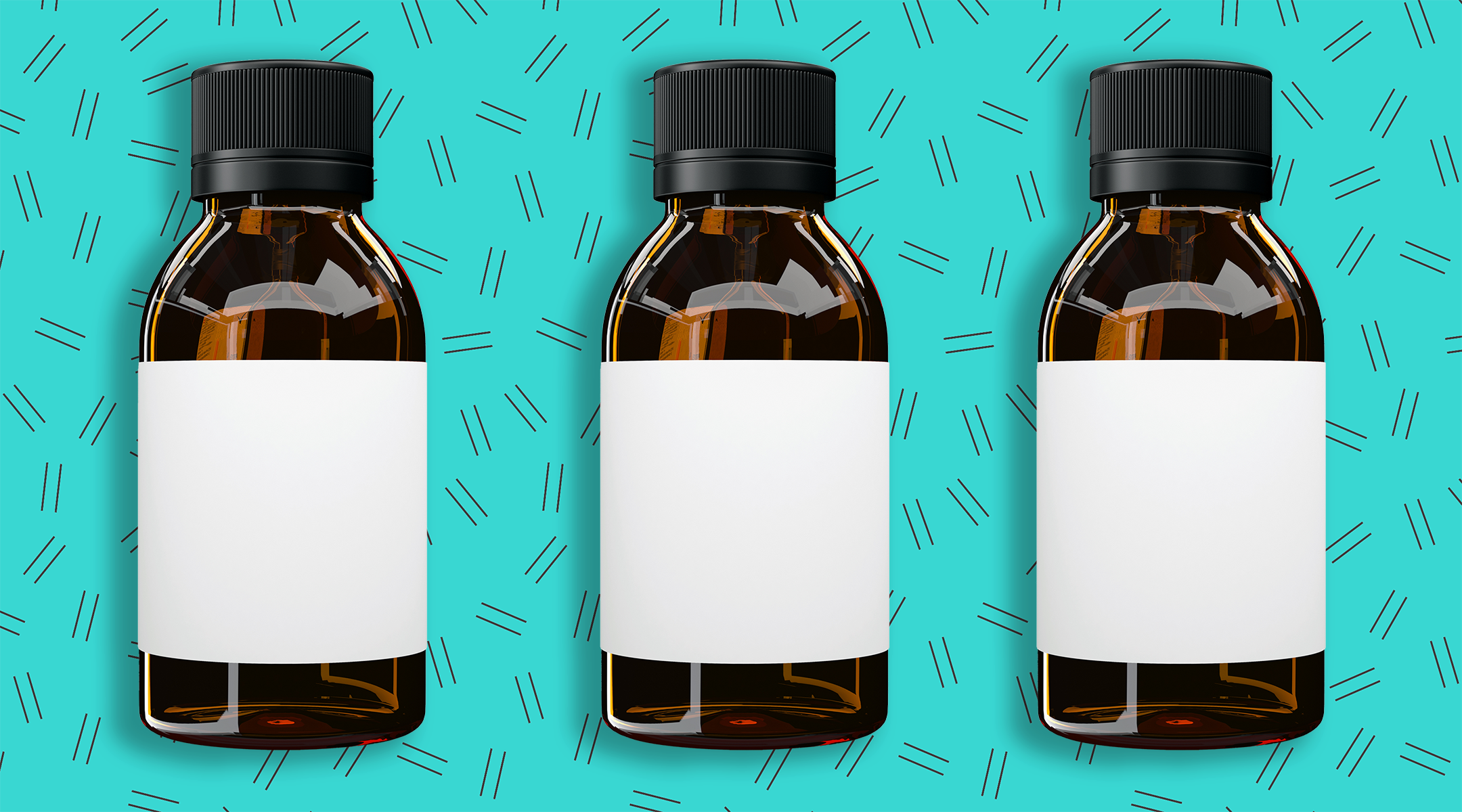 glass medicine bottles on pattern background