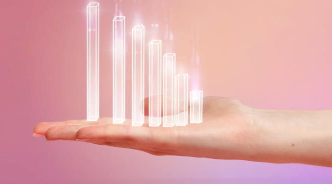 conceptual image of hand holding neon increasing bar graph