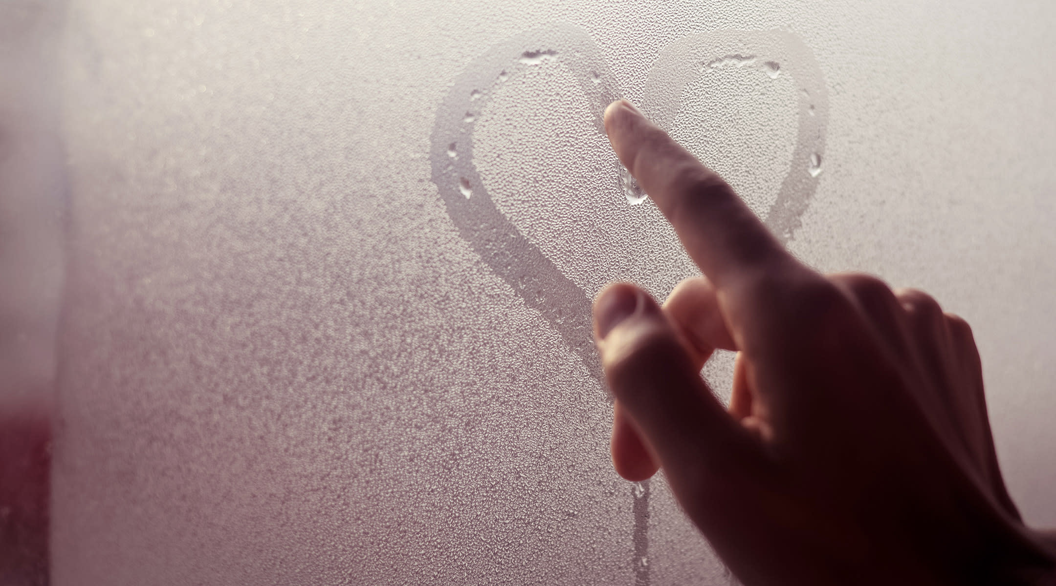 hand drawing heart glass condensation