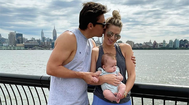Former bachelor star Lesley Anne Murphey holds her baby with her fiance.