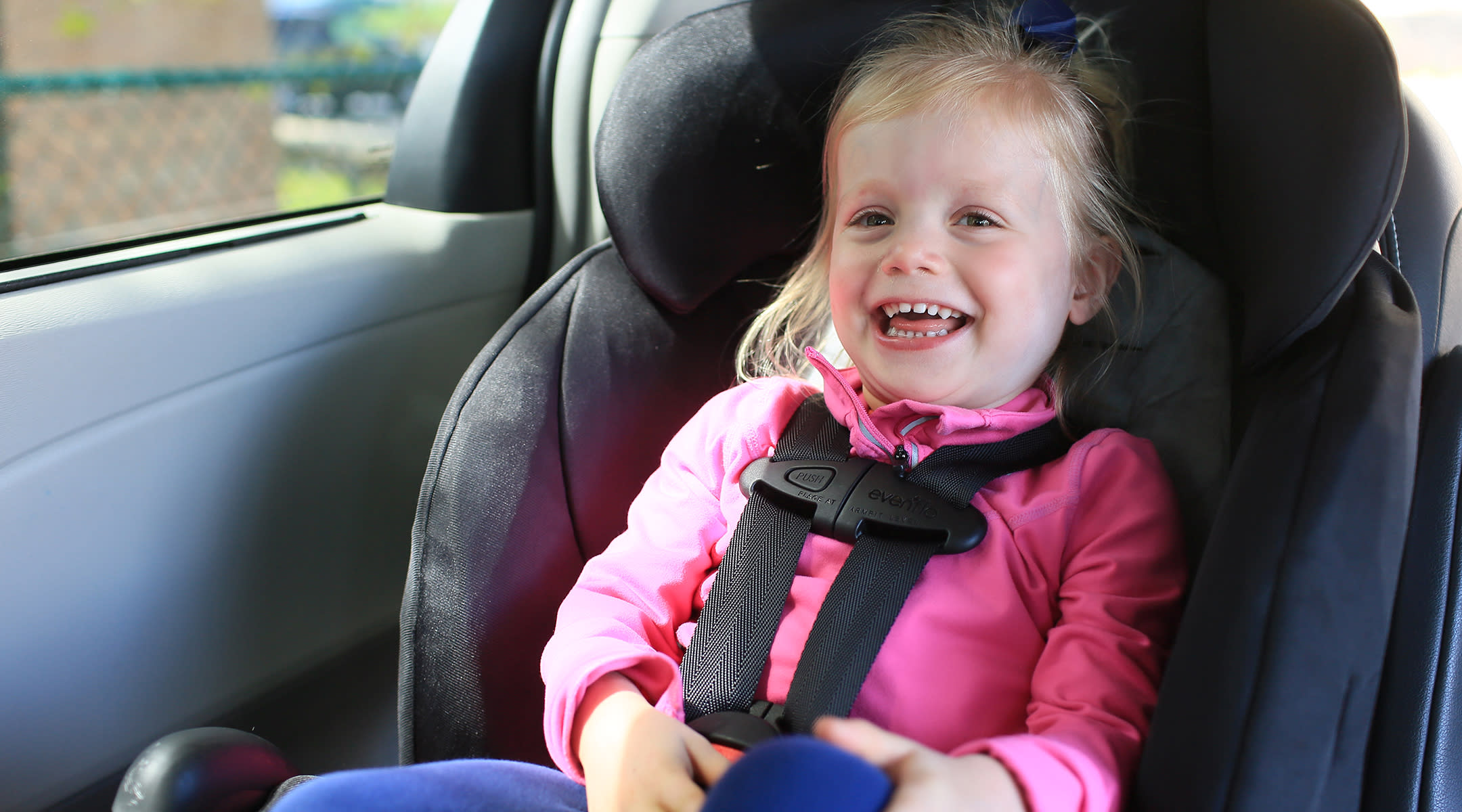 Girl sitting in a convertible car seat