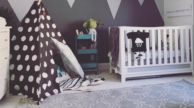 kids nursery with polka dot tee-pee set up