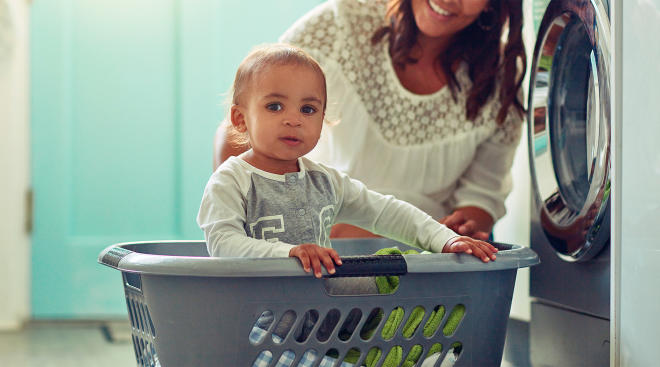 mom doing laundry for baby with sensitive skin
