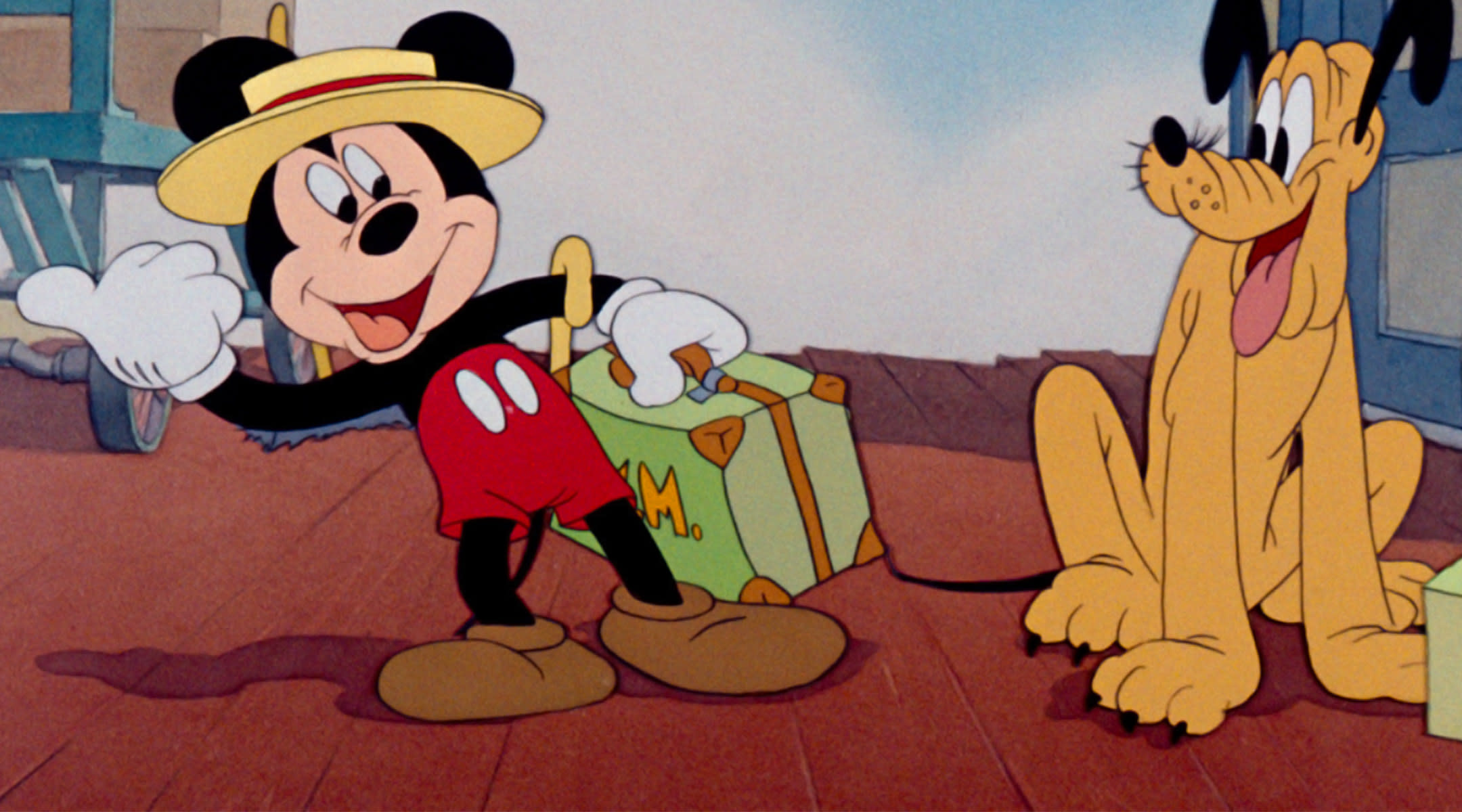 cartoon mickey mouse and pluto getting ready for a trip
