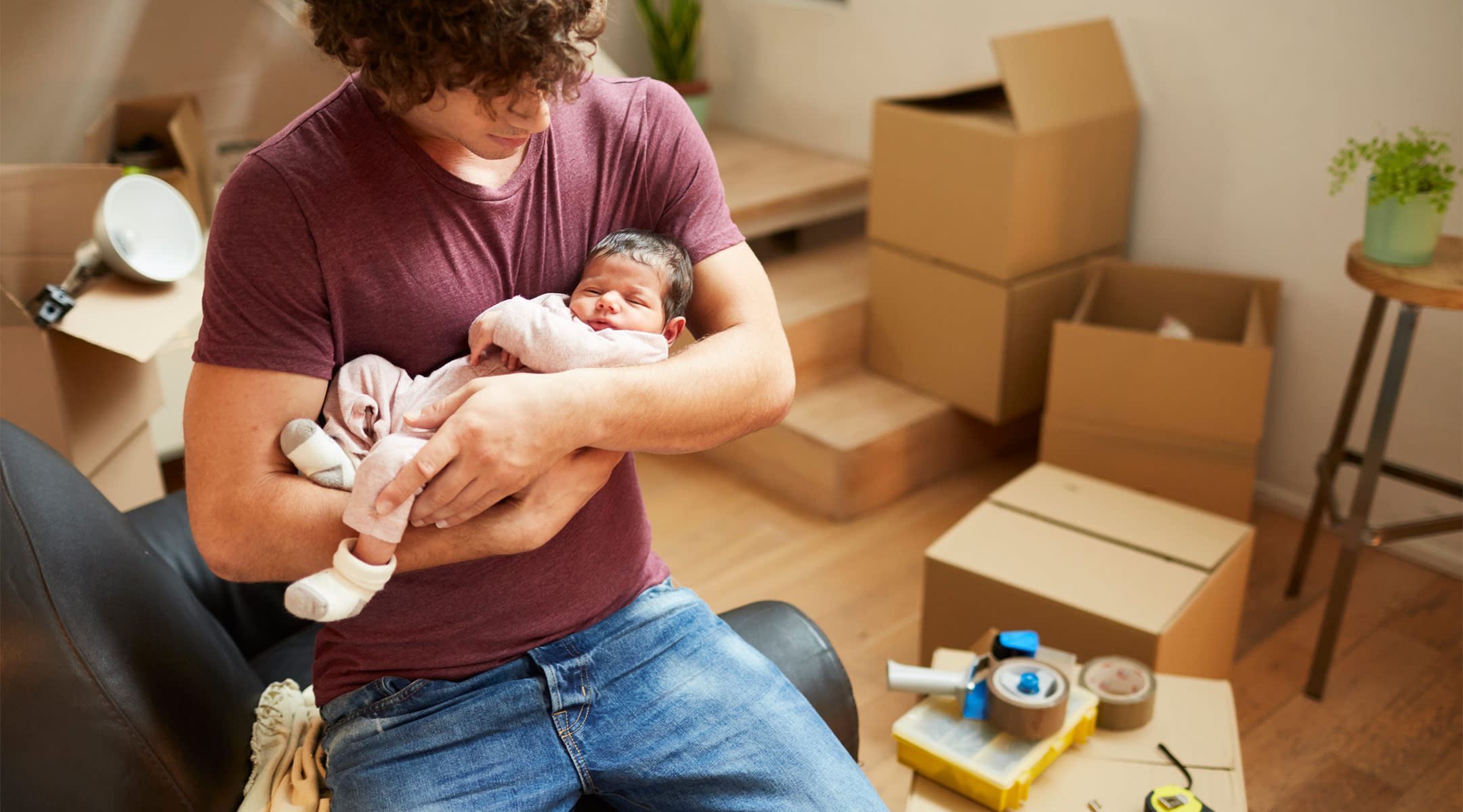 couple is forced to pack up their stuff and move after having a baby.