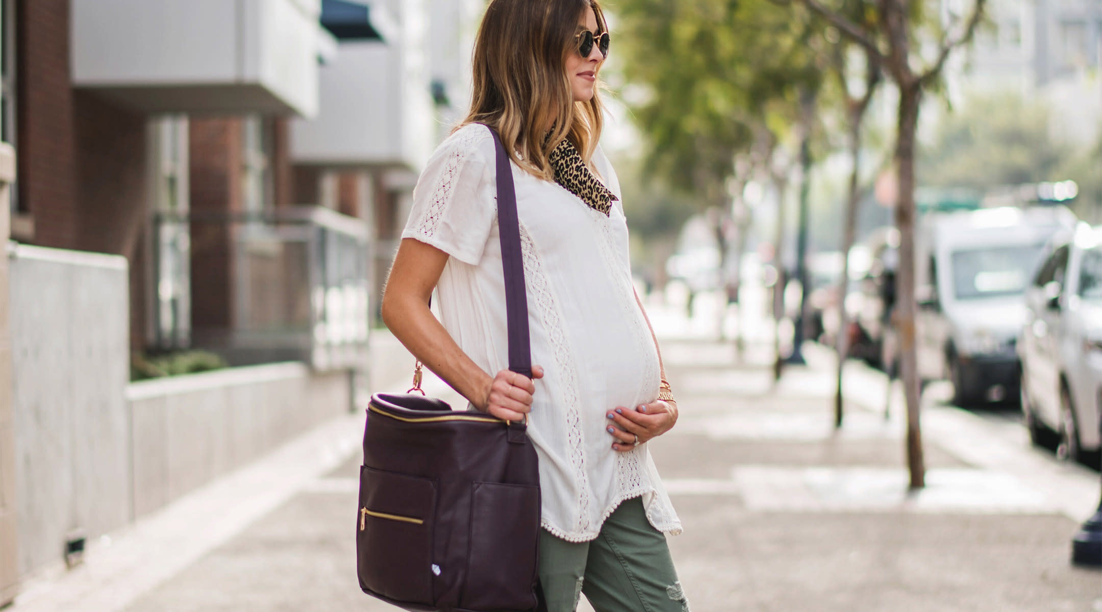pregnant woman wearing work outfit