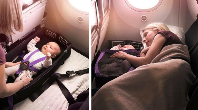 woman sleeping on plane with her baby in a pod
