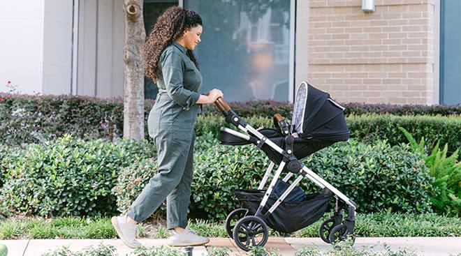 Woman pushing her baby in a Mocking Bird stroller.
