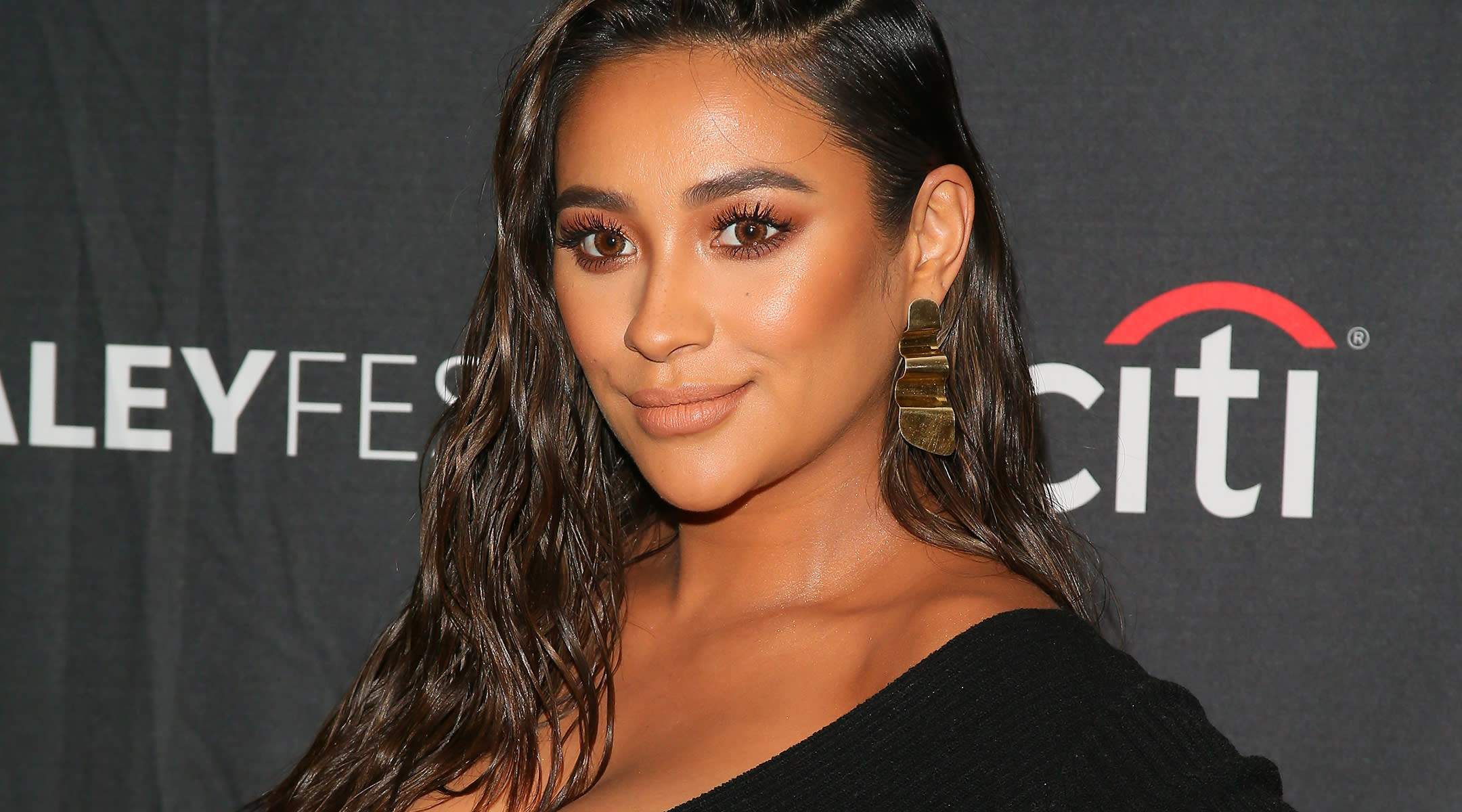 Shay Mitchell poses on red carpet