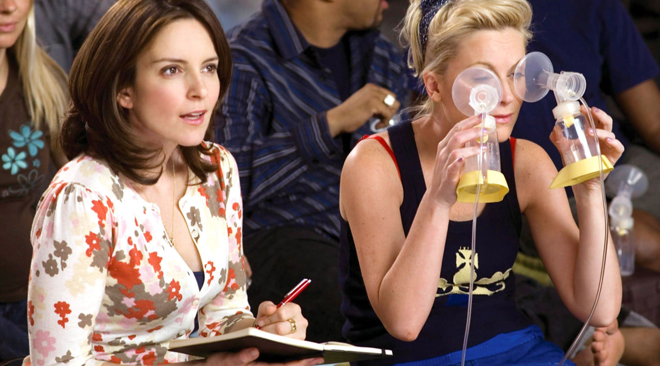 still from the movie baby mama, tina fey and amy poehler attending a baby class