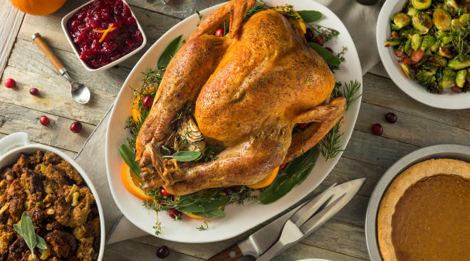 table with thanksgiving turkey and other foods