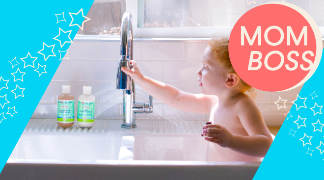 toddler in kitchen sink using california baby products