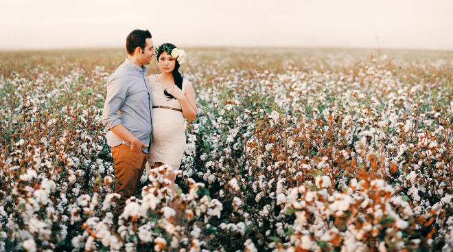 maternity shoot couple floral crown field