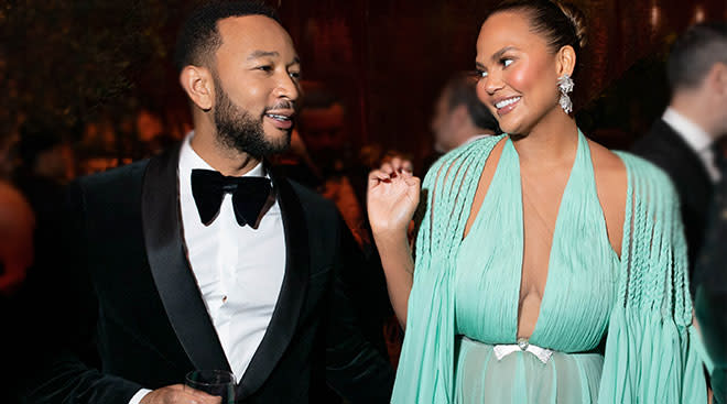 chrissy teigen and john legend at an event