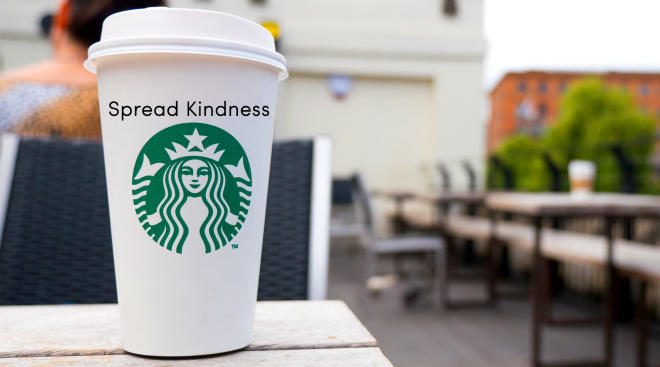 starbucks to go cup with spread kindness messaging