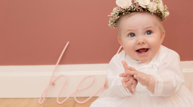 happy baby on her baptism day