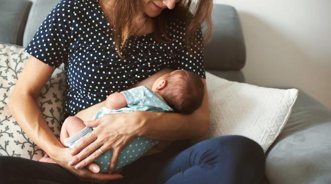 mom breastfeeding her newborn baby