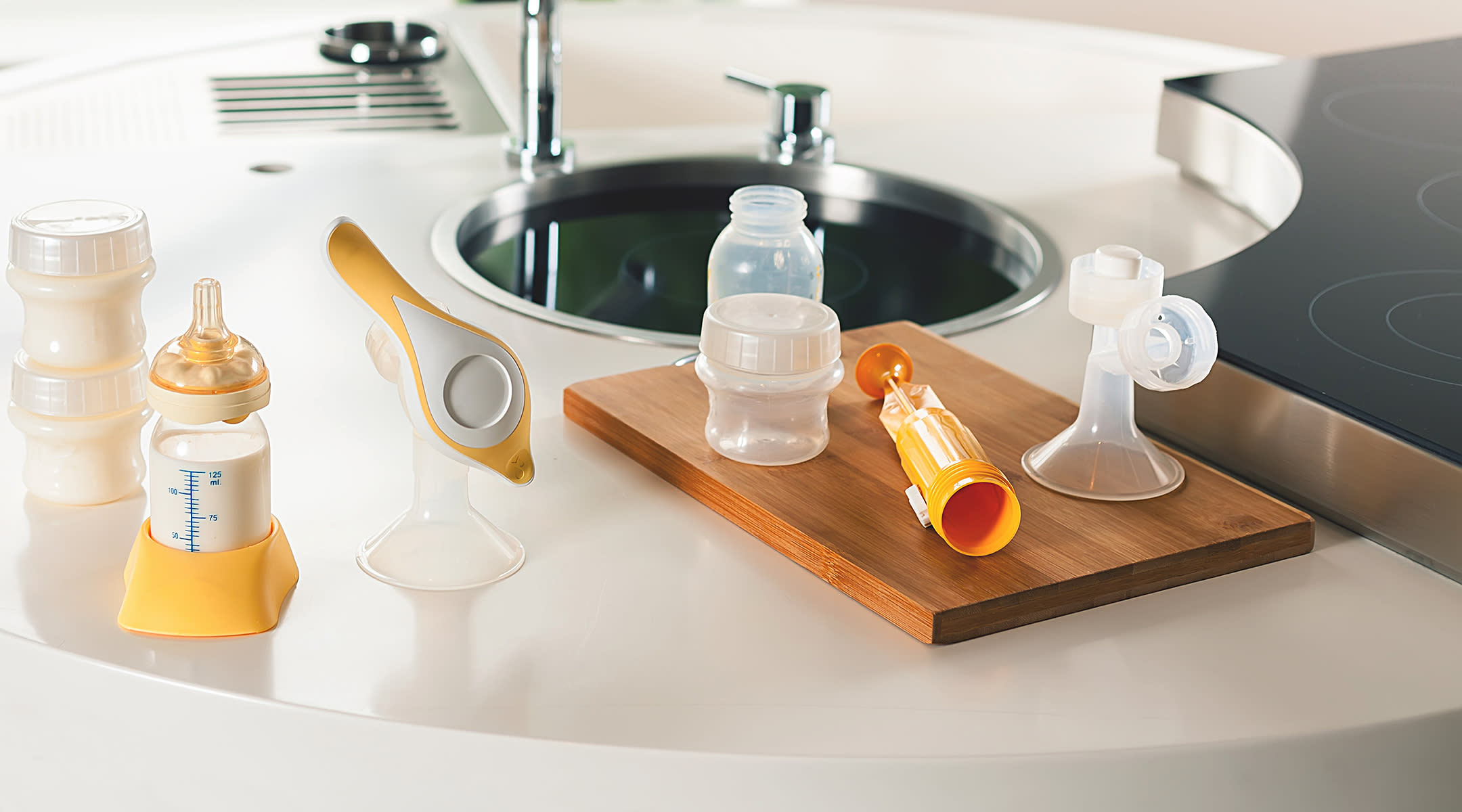 breast pump materials on kitchen counter
