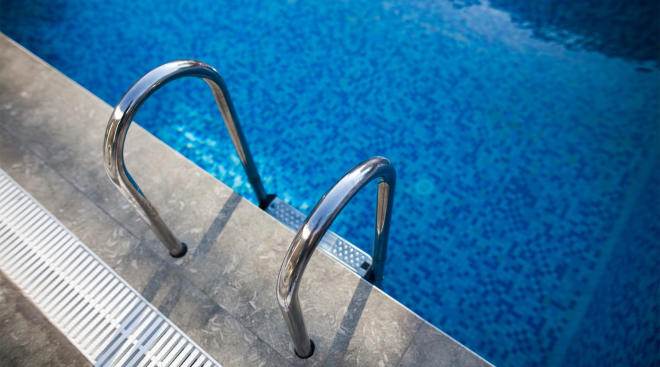 close up of swimming pool with step ladder