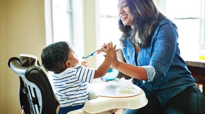 mom feeding her baby son dinner
