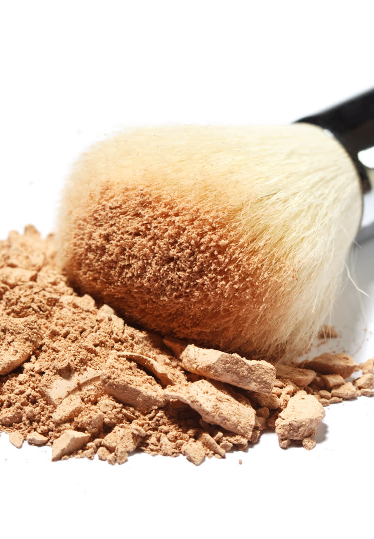 Detail of make-up brush with powder foundation.