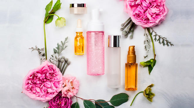 beauty products arranged with flowers