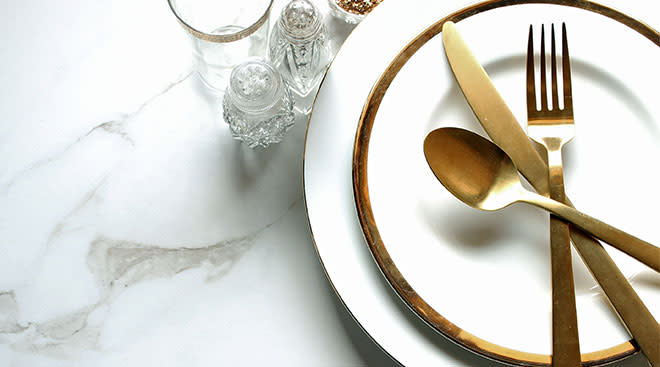 place setting for one with gold accents